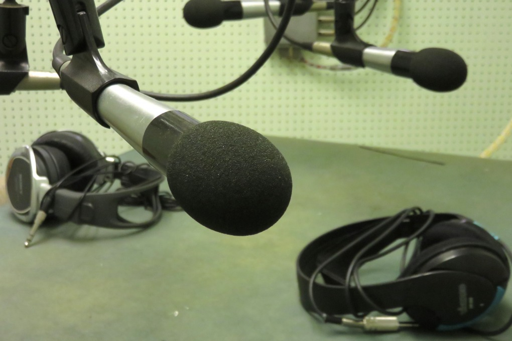 Picture showing some microphones and headphones